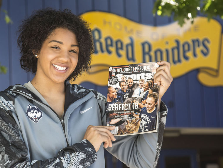 Tribune photo by John Byrne - Reed grad and current UCONN women's basketball player Gabby Williams holds up the Sports Illustrated cover she was featured on (second from the left) after the Huskies won their third-straight national title this spring. Williams was named the American Athletic Conference's Sixth Player of the Year and was named to the AAC All-Freshman team.