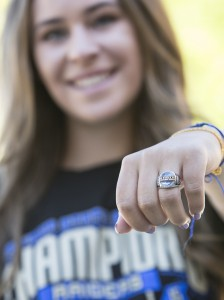 Tribune photo by John Byrne - Reed junior pitcher Julia Jensen shows off her 2015 state championship ring that the team received at a ceremony Friday morning in front of the entire student body and staff.