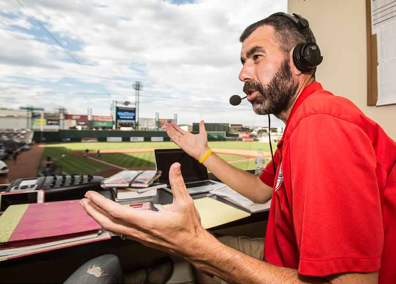 Reno Aces radio play-by-play commentator Ryan Radtke goes though his pregame show at Aces Ballpark on Friday. Radtke also does play-by-play for the Nevada football and men's basketball teams. (John Byrne)