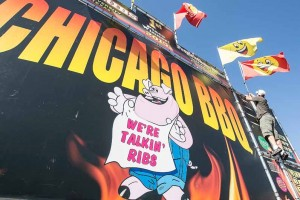 John Byrne/Tribune Steve Weber places a flag on Chicago BBQ's display in preparation for the 27th annual Best in the West Nugget Rib Cook-Off, which runs from Wednesday through Monday. See a schedule of Rib Cook-Off events on page 6.