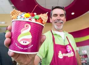 John Byrne/Tribune Roland Trub, owner of the new Menchie's Frozen Yogurt shop in Sparks