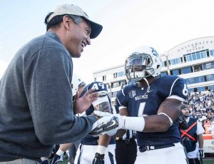 John Byrne/Tribune Gov. Brian Sandoval (left) shakes hands with Nevada senior running back Don Jackson before Saturday's Battle for the Fremont Cannon between Nevada and UNLV at Mackay Stadium. Sandoval is a graduate of the University of Nevada, Reno who rarely hides his allegiance to the Wolf Pack. But he wore a hat that featured both the Wolf Pack and Rebel logos for the rivalry game's coin toss. Governor's support or not, Nevada fell to UNLV, 23-17.