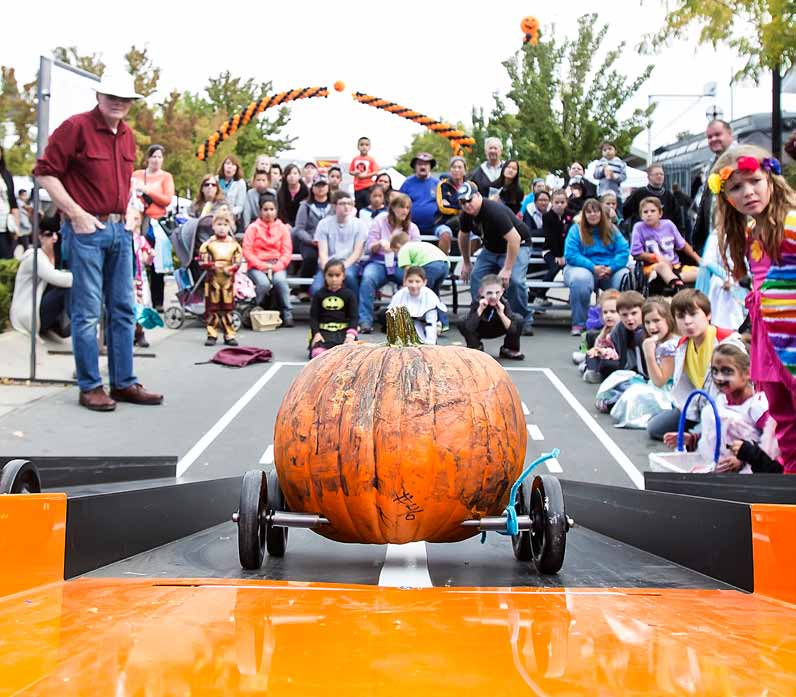 John Byrne/Tribune A pumpkin heads down the elevated runway toward its owner at the finish line during the annual Pumpkin Derby, part of Sunday's PumpkinPalooza activities at Victorian Square. Organizers said the event, which benefits the Northern Nevada Center for Independent Living, attracted about 8,500 people to downtown Sparks.