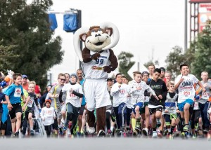 John Byrne/Tribune Bruno, the mascot for the Reno Bighorns basketball team, leads the way during the first race Sunday at the Education Run.