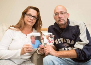 John Byrne/Tribune Elizabeth Estes, left, and her brother, Don Duckett, pose with photos of their dad, Donald Duckett, who died after he was struck by a car while crossing Prater Way in his motorized wheelchair.