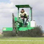Company brushing artificial turf at Golden Eagle park