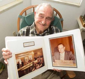 John Byrne/Tribune Valdo Renucci displays a scrapbook containing photos of his time as a member of the Sparks City Council beginning in 1975. Renucci, 94, who was born in Sparks, remembers when the city had hitching posts for horses on B Street, now known as Victorian Avenue.