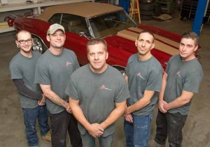 John Byrne/Tribune Jason Oppio, third from left, has taken over ownership of Al's Rod and Custom shop in Sparks from his father, Al Oppio.  The younger Oppio stands in the shop  surrounded by employees, from left to right, Cavin Bowers, Keith Bishop, Tom Scalzi and Eric Bruner.  The Oppio family has deep roots in Sparks.