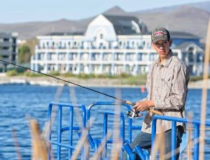 John Byrne/Tribune Jose Garcia enjoys some time fishing off the pier at the Sparks Marina last weekend.