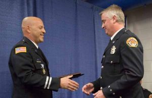 John Byrne/Tribune Sparks Fire Department Captain Joe Warner (left) presents the Fireman of the Year award to Rich Armstrong (right) last Thursday.