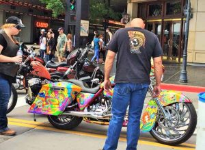 Dawn Cranfield A biker checks out a colorful motorcycle at the Street Vibrations Spring Rally in downtown Reno over the weekend.