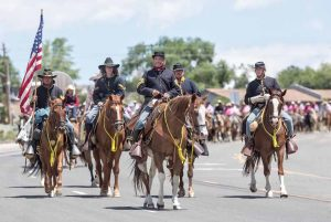 John Byrne photos/Tribune -Members of the 1st Nevada Cavalry lead the annual cattle drive into the Biggest Little City on Thursday to kick off the Reno Rodeo at the Livestock Events Center.