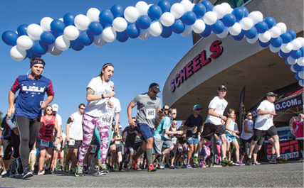 John Byrne/Tribune- The 3rd annual Dash for Dads race was held Sunday morning at Scheels in Sparks, hosted by Cancer Awareness of Nevada. More than 100 participants took part in the 5K event that raised money for local cancer patients.