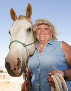 John Byrne/Tribune Kathy Galles with one of her 10 horses involved in the Sierra Nevada Horses and Heroes program located in Spanish Springs.