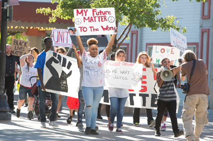 John Byrne/Tribune - About 75 people participated in a Black Lives Matter march on Friday that began on the west side of Victorian Avenue in Sparks. Marchers of all races told stories and gave testimonials speaking out against recent police brutality. Police said the rally went peacefully. The group plans another march in Carson City on Saturday at 6 p.m.