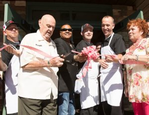 John Byrne/Tribune Sparks Mayor Gino Martini (second from left) cuts the ribbon at the Sparks Campo grand opening last Thursday. It's the restaurant's second location in Northern Nevada.