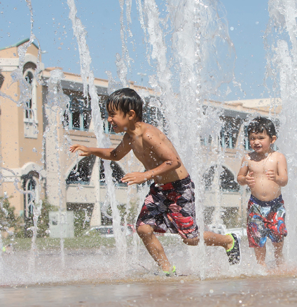 John Byrne/Tribune Children in Sparks enjoyed an afternoon cooling off from the summer heat at the interactive water fountain in Victorian Square on Monday. Temperatures were in the high 90s most of the weekend after reaching triple digits three straight days beginning last Wednesday.