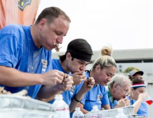 John Byrne/Tribune file photo -  World champion eaters Joey Chestnut (left) and Matt Stonie (second from left) battle it out in the 10th annual Nugget World Rib-Eating Championship last year in Victorian Square. Both will return for the contest this year which will be held tomorrow night during the weeklong Best in the West Nugget Rib Cook-Off.