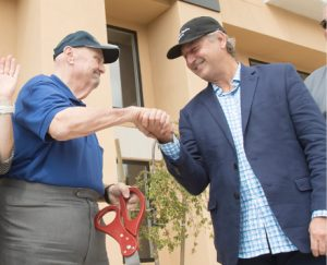 John Byrne/Tribune -  Sparks Mayor Geno Martini (left) shakes hands with LandCap Investment CEO Stephen Hinckley at the Square One Apartments grand opening last Thursday. LandCap converted the vacant Silver Club Hotel building into the new urban style apartments as part of the downtown Sparks redevelopment.