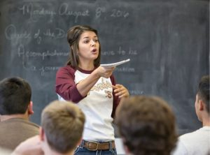 John Byrne/Tribune Sparks High government teacher Tawnya Beck speaks to her students Monday morning during the first class of the new school year. Beck will be pulling double duty for the home town school as she takes on the role of girls varsity basketball coach.