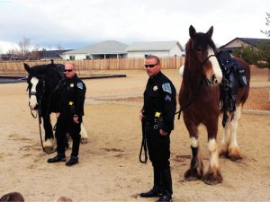 Courtesy photos - Sparks Police officer Dan Snow (left) and Sergeant Mike McCreary speak to students at Spanish Springs Elementary School about the departments Mounted Unit.