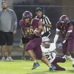 John Byrne photos/Tribune Sparks running back Aleki Po'oi breaks free from a Dayton defender during he Railroaders 41-15 win Friday night. Po'oi led all rushers with 104 yards and a touchdown.