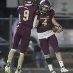 Cole Meacham celebrates with Railroader quarterback Tyler Green after a touchdown in Friday night's win over Dayton.