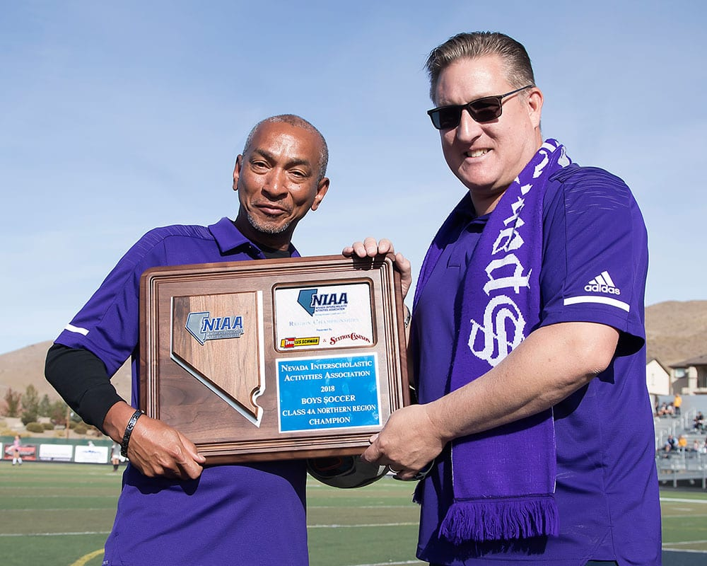 Cougar coaches display the 2018 NIAA 4A boys soccer championship plaque Saturday. Spanish Springs will play Friday in the state semifinals in Las Vegas.