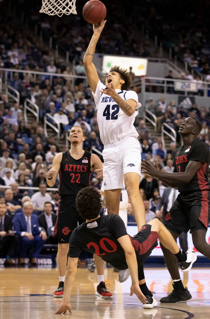 John Byrne photos/Tribune  Nevada's K.J. Hymes goes up for a shot Saturday night in a 83-76 loss to San Diego State.