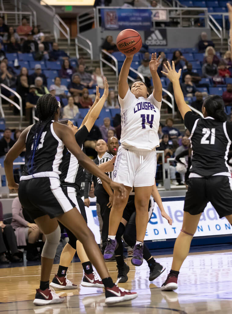 John Byrne/Tribune  Autumn Wadsworth shoots with three defenders nearby during the state semifinals last week in Reno. The Cougars fell to Desert Oasis, 56-48.